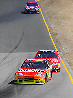Jun. 21, 2009; Sonoma, CA, USA; NASCAR Sprint Cup Series driver Jeff Gordon (24) leads Tony Stewart and Kyle Busch during the SaveMart 350 at Infineon Raceway. Mandatory Credit: Mark J. Rebilas-