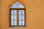 Adobe wall with window in Santa Fe, New Mexico.