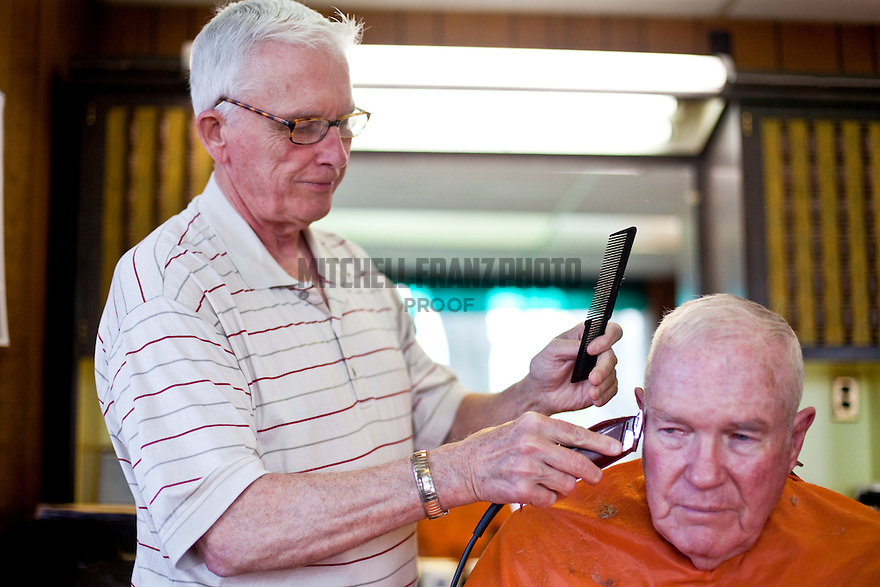 John Murray trims Bernie Mahoney's, former Common Councilor and Syracuse politician, hair in his barbershop located at 4403 S. Salina St.