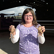 Cowboy Church. Texas, USA. 2007. A girl at the Cowboy Church who found some frogs behind the barn.