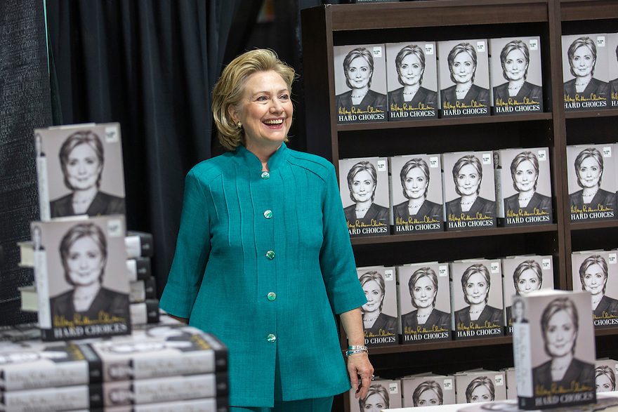 Former Secretary of State Hillary Clinton attends a signing her new book, 'Hard Choices: A Memoir,' at Costco in Arlington, VA.  Clinton is on a nationwide tour to promote the new memoir with a book signings, speeches & media interviews.   She is not expected to decide on whether to run for President before the end of the year.
