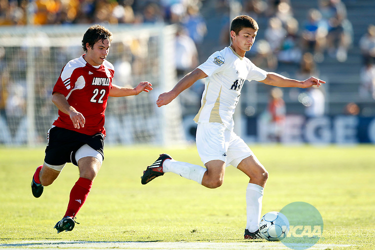 12 DEC 2010:  Perry Kitchen (5) of the University of Akron races past Dylan Mares (22) of the University of Louisville during the Division I Men's Soccer Championship held at Harder Stadium on the University of California- Santa Barbara campus in Santa Barbara, CA.  Akron defeated Louisville 1-0 for the national title.  Jamie Schwaberow/NCAA Photos