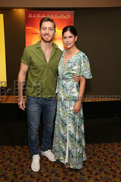 "Adam Jepson and guest attends the Broadway screening of the Motion Picture Release of ""The Lion King"" at AMC Empire 25 on July 15, 2019 in New York City."