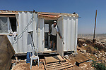 Avraham Heusman, a settler, at his caravan house in the unauthorized Israeli outpost of Bnei Adam, West Bank.