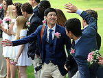 Noppavut Khunpinit, left and Yifei Wang, prepare to high five, as the students  start to march, prior to the Loomis Chaffee graduation ceremony, Sunday, May 29, 2016, at the school in Windsor. (Jim Michaud / Journal Inquirer)