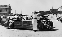BNPS.co.uk (01202 558833)<br /> Pic: NMM/BNPS<br /> <br /> Major Henry Seagrave with the Golden Arrow at Daytona in 1929.<br /> <br /> Golden shot in the arm - Beautiful record breaker Golden Arrow is to receive new funding 90 years after smashing the Land speed record for Britain.<br /> <br /> The National Motor Museum at Beaulieu has been awarded £75,000 by Arts Council England to allow fresh research into the historic machine and the collections relating to it, as well as some conservation work on particularly fragile items.  <br /> <br /> The distinctive 1929 Golden Arrow was a wonder of its time, a harmonious blend of technology and design, produced a masterpiece of Art Deco expression which paved the way for two decades of unbroken British world record-breaking success.<br /> <br /> With Major Henry Segrave in the driving seat,  the arrow shattered its target and set a new Land Speed Record of 231.36mph at Daytona Beach in Florida in March 1929.