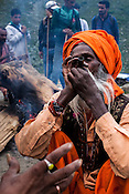 A Sadhu (Hindu Holyman) smokes a joint in Chandanwari, the base camp of the journey in Kashmir, India. Hindu pilgrims brave sub zero temperature and high latitude passes and make their pilgrimage to reach the sacred Amarnath cave, which houses a lingam - a stylized phallus, worshiped by Hindus as a symbol of God Shiva. Photo: Sanjit Das/Panos