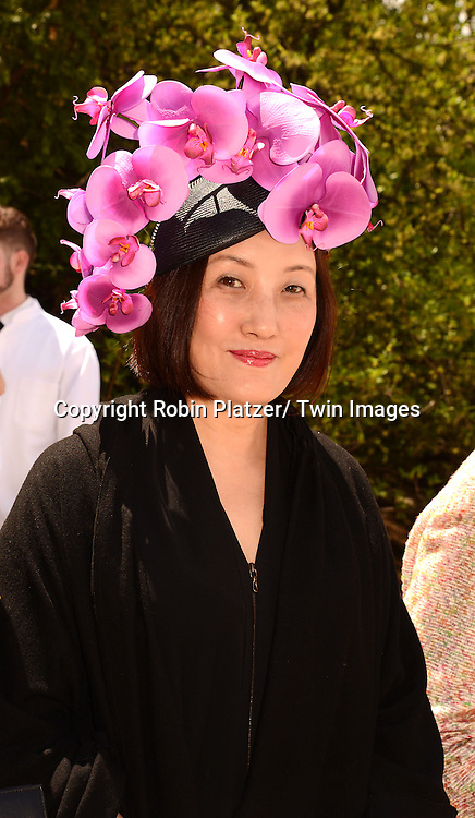 Nan Song attends the 32nd Annual Frederick Law Olmsted Awards Hat Luncheon given by The Central Park Conservancy on May 7,2014 in Central Park in New York City, NY USA.
