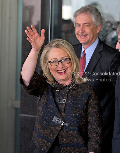 United States Secretary of State Hillary Rodham Clinton departs the State Department on her last day on the job in Washington, D.C. on Friday, February 1, 2013.  U.S. Deputy Secretary of State William J. Burns looks on from right..Credit: Ron Sachs / CNP.(RESTRICTION: NO New York or New Jersey Newspapers or newspapers within a 75 mile radius of New York City)