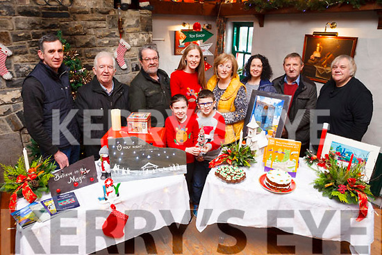 Getting ready for a craft fair taking place in The Tatch Lisselton on this Sunday December 17th, a fundraiser for next year's Bardic Festival, were: John O'Connor, Jim Finnerty, John McGrath, Joanne Riordan O'Connor, Noelle Hegarty, Orla Walsh, Martin Moore, Barbara Derbyshire with children Katie and Dylan Walsh.