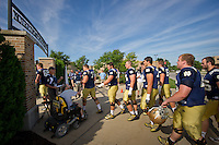 The Irish walk into at the LaBar Practice Complex.