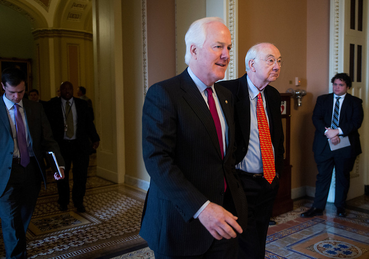 UNITED STATES - FEBRUARY 7: Sen. John Cornyn, R-Texas, left, and former Sen. Phil Graham, R-Texas, walk towards Senate Minority Leader Mitch McConnell's office in the Capitol on Thursday, Feb. 7, 2013. (Photo By Bill Clark/CQ Roll Call)