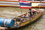 Family on boat in the Chao Phraya River, Bangkok, Thailand
