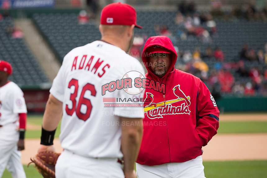 Hitting coach Phillip Wellman #30 of the Springfield Cardinals talks with Matt Adams #53 of the St. Louis Cardinals prior to a game against the Tulsa Drillers at Hammons Field on May 4, 2013 in Springfield, Missouri. Adams was on a four game rehab assignment in Springfield. (David Welker/Four Seam Images)
