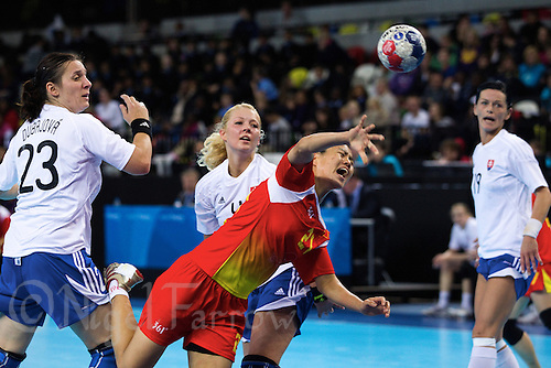 23 NOV 2011 - LONDON, GBR - China's Zhao Jiaqin (#21, in red and yellow) shoots during the 2011 London Handball Cup match against Slovakia at The Handball Arena in the Olympic Park in Stratford, London (PHOTO (C) NIGEL FARROW)