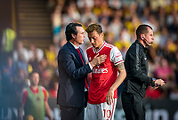 Arsenal manager Unai Emery with Mesut Özil of Arsenal after the player is substituted during the Premier League match between Watford and Arsenal at Vicarage Road, Watford, England on 16 September 2019. Photo by Andy Rowland.