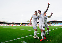 Peterborough United's Matthew Godden, left, celebrates scoring his side's second goal with team-mates Jason Cummings, centre, and Joe Ward<br /> <br /> Photographer Chris Vaughan/CameraSport<br /> <br /> The EFL Sky Bet League One - Scunthorpe United v Peterborough United - Saturday 13th October 2018 - Glanford Park - Scunthorpe<br /> <br /> World Copyright &copy; 2018 CameraSport. All rights reserved. 43 Linden Ave. Countesthorpe. Leicester. England. LE8 5PG - Tel: +44 (0) 116 277 4147 - admin@camerasport.com - www.camerasport.com