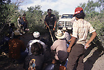 A U.S. Border Patrol agent in Del Rio, Texas, detains a group of suspected illegal aliens.While the traditional mission of the United States Border Patrol has always been the detection and prevention of the illegal entry of aliens and smuggling of illegal contraband into the United States anywhere other than a designated port-of-entry, the dawn of the age of terrorism within our nation has added a new and high priority mission: to detect and prevent the entry of terrorists and their weapons into the United States. Jim Bryant Photo..©2006. All Rights Reserved.