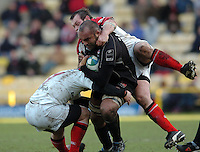 2005/06, Heineken Cup, 4th Rd, Saracens vs Ulster,  Saracen's, Simon Raiwalui is tackled by the Ulster defenders as he attacks with the ball. Vicarage Road, ENGLAND   © Peter Spurrier/Intersport Images - email images@intersport-images..