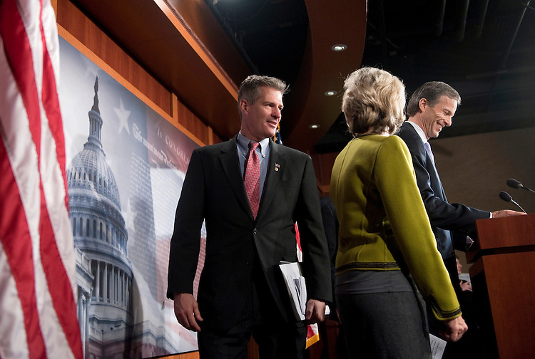 "UNITED STATES - FEBRUARY 16: Sen. Scott Brown, R-Mass.; Sen. Kay Bailey Hutchison, R-Texas; and Sen. John Thune, R-S.D., speak at a press conference ""to discuss four bipartisan House-passed jobs bills currently being blocked by the Senate Democrat leadership.""(Photo By Chris Maddaloni/CQ Roll Call)"