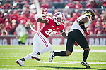 Wisconsin Badgers defensive back Derrick Tindal (25) makes a tackle during an NCAA Big Ten Conference football game against the Maryland Terrapins Saturday, October 21, 2017, in Madison, Wis. The Badgers won 38-13. (Photo by David Stluka)