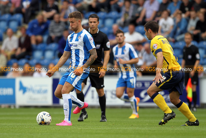 George Moncur of Colchester United with the ball during Colchester United vs Scunthorpe United, Sky Bet League 1 Football at the Weston Homes Community Stadium, Colchester, England on 29/08/2015