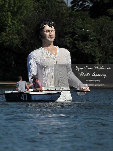 A boat passes Mr Darcy in the Serpentine as part of a launch for a new TV channel. Serpentine Lido. Hyde Park. London. UK. 08/07/2013. MANDATORY Credit Garry Bowden/SIPPA - NO UNAUTHORISED USE - 07837 394578