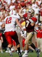 TALLAHASSEE, FL 10/31/09-FSU-NCST FB09 CH38-Florida State's Christian Ponder throws as N.C. State's Audie Cole closes during second half action Saturday at Doak Campbell Stadium in Tallahassee. The Seminoles beat the Wolf Pack 45-42..COLIN HACKLEY PHOTO