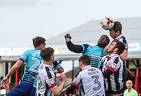 Danny Collins of Grimsby Town clears from Adebayo Akinfenwa of Wycombe Wanderers during the Sky Bet League 2 match between Grimsby Town and Wycombe Wanderers at Blundell Park, Cleethorpes, England on 4 March 2017. Photo by Andy Rowland / PRiME Media Images.