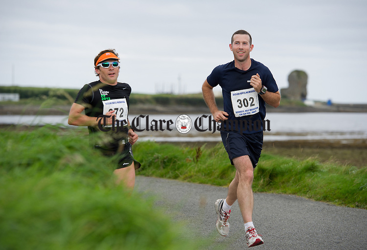 Felix O Shaughnessy and John O Brien in action during the Declan Hayes Memorial Doonbeg Half Marathon/10K Fun Run and Walk. Photograph by John Kelly.