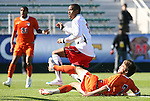 16 November 2008: Maryland's Jeremy Hall (in white) beats Virginia's Neil Barlow (7) and score's the game's only goal. The University of Maryland defeated the University of Virginia 1-0 at WakeMed Stadium at WakeMed Soccer Park in Cary, NC in the men's ACC tournament final.