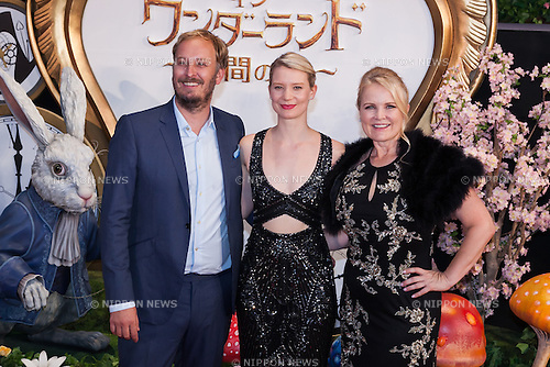(L to R) Director James Bobin, Australian actress Mia Wasikowska and American film and television producer Suzanne Todd pose for the cameras during the Japan premiere for the film Alice Through the Looking Glass on June 21, 2016, Tokyo, Japan. Wasikowska wearing a elegant black dress was joined by producer Suzanne Todd and director James Bobin to promote their sequel to Alice in Wonderland (2010) at Roppongi Hills Arena. The film hits Japanese theaters on July 1st. (Photo by Rodrigo Reyes Marin/AFLO)