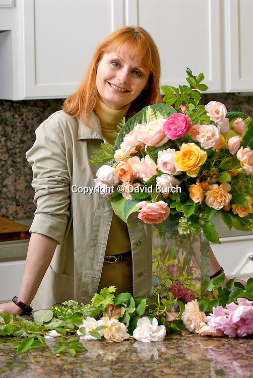 Mature woman with flower arrangement