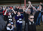 Visiting fans in the away end react with delight  at the final whistle as East Stirlingshire take on Edinburgh City in the second leg of the Scottish League pyramid play-off at Ochilview Park, Stenhousemuir. The play-offs were introduced in 2015 with the winners of the Highland and Lowland Leagues playing-off for the chance to play the club which finished bottom of Scottish League 2. Edinburgh City won the match 1-0 giving them a 2-1 aggregate victory making them the first club in Scottish League history to be promoted into the league.