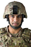 Close up studio portrait of  American Army soldier Ali looking at camera with white background