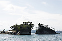 A general view of Matsushima Bay seen from a boat as part of the ''1000km Relay to Tokyo 2016'' promotion event in Matsushima on July 30, 2016, Miyagi, Japan. There are about 260 small islands in the bay, whose name means Pine Islands. At the time of the March 2011 earthquake and tsunami the islands served as a natural barrier weakening the impact of the tsunami on the coastal town. Matsushima is one of the most popular spots to visit for tourists in the region. (Photo by Rodrigo Reyes Marin/AFLO)