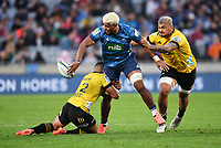 14th June 2020, Aukland, New Zealand;  Hoskins Sotutu is tackled and lays the ball off  at the Investec Super Rugby Aotearoa match, between the Blues and Hurricanes held at Eden Park, Auckland, New Zealand.