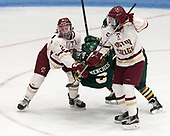 Grace Bizal (BC - 2), Kourtney Menches (UVM - 2), Andie Anastos (BC - 23) -  The Boston College Eagles defeated the University of Vermont Catamounts 4-3 in double overtime in their Hockey East semi-final on Saturday, March 4, 2017, at Walter Brown Arena in Boston, Massachusetts.