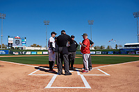 Oregon State Beavers manager Mitch Canham (11) meets with New Mexico head coach Ray Birmingham and the umpire crew before an NCAA game against the New Mexico Lobos at Surprise Stadium on February 14, 2020 in Surprise, Arizona. (Zachary Lucy / Four Seam Images)