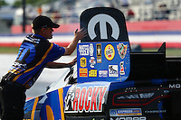 May 15, 2015; Commerce, GA, USA; A crew member opens the roof escape hatch for NHRA funny car driver Matt Hagan during qualifying for the Southern Nationals at Atlanta Dragway. Mandatory Credit: Mark J. Rebilas-USA TODAY Sports
