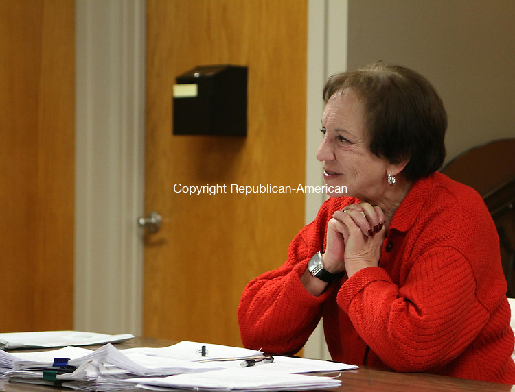 WATERTOWN, CT 13 February 2014-021314LW03 - Watertown Housing Authority Director Patricia Norman listens to  Chairman Mark Raimo during a meeting at Truman Terrace Wednesday night.<br /> Laraine Weschler Republican-American