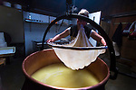 Anita Kathriner and Raphael Wyss make Alpkase, Mutschli (traditional alps cheeses), and butter by hand in the traditional manner, in a giant copper kettle over an open, wood burning fire at their cheese-making hut above Wengen, Switzerland.  The milk comes from the cows directly grazing in the pastures around the property and is located right on the Jungfrau railway line.
