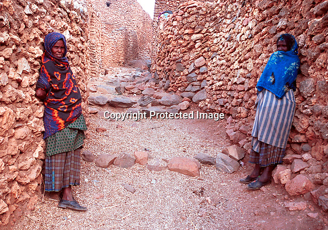 dicoeth00080.Ethiopia. Women standing against the walls of a stone town on February 8, 2001 in Erer Valley in rural eastern Ethiopia. In this primarily muslim area, a project against Female Genital Mutilation (FGM) has made success in several rural villages in this area in stopping the practice. .©Per-Anders Pettersson/iAfrika Photos