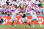 Alex Davis of England (L) tries to tackle Heino Bezuidenhout of South Africa (C) during the HSBC Hong Kong Sevens 2018 match between South Africa and England on April 7, 2018 in Hong Kong, Hong Kong. Photo by Marcio Rodrigo Machado / Power Sport Images
