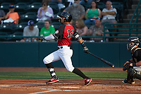 Miguel Aparicio (36) of the Hickory Crawdads follows through on his swing against the Kannapolis Intimidators at L.P. Frans Stadium on July 20, 2018 in Hickory, North Carolina. The Crawdads defeated the Intimidators 4-1. (Brian Westerholt/Four Seam Images)