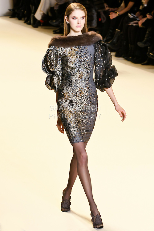 Taryn Davidson walks the runway in a prussian blue mosaic embroidered off the shoulder full sleeve dress with smoke grey sable trim, by Carolina Herrera, for her Carolina Herrera Fall 2010 collection, during Mercedes-Benz Fashion Week Fall 2010.