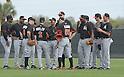 Reed Johnson, Brett Butler, Ichiro Suzuki, Marcell Ozuna (Marlins),<br /> FEBRUARY 24, 2014 - MLB :<br /> Ichiro Suzuki of the Miami Marlins listens to third base coach Brett Butler during the Miami Marlins spring training camp in Jupiter, Florida, United States. (Photo by AFLO)