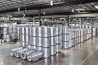 sheet metal rolls, raw material at metal fabrication factory