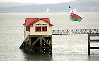 A Wales flag in the shape of a red lobster instead of a red dragon is raised outside Mumbles Pier, to raise awareness for Skin Care Cymru, in Wales, UK. Tuesday 28 February 2017