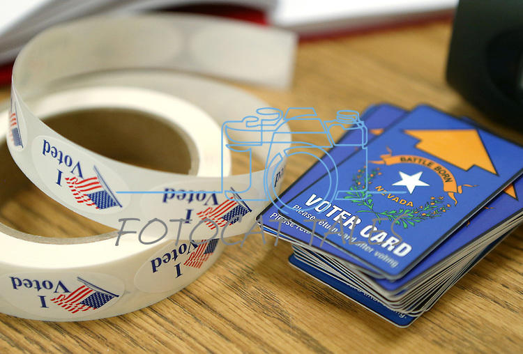Election stickers and voter cards sit ready in Reno, Nev., on Tuesday, Nov. 4, 2014. (AP Photo/Cathleen Allison)